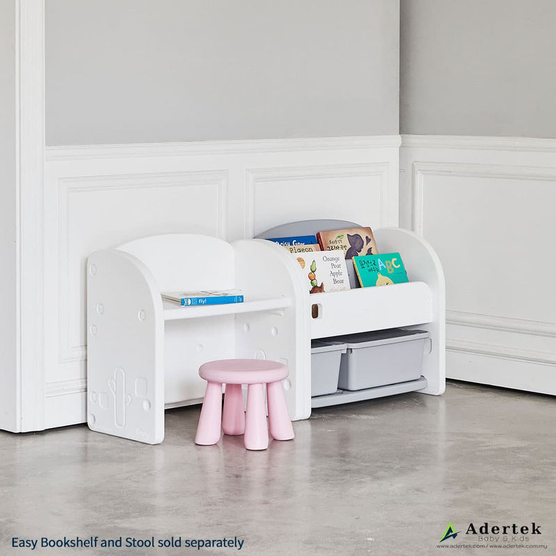 Side view of toddler desk with pink kids chair and storage organiser.