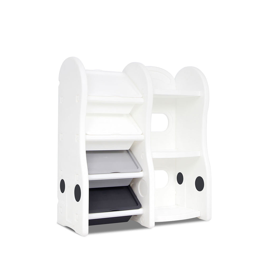 Children's toy storage organiser in white with 4 storage boxes beside a children's bookshelf.