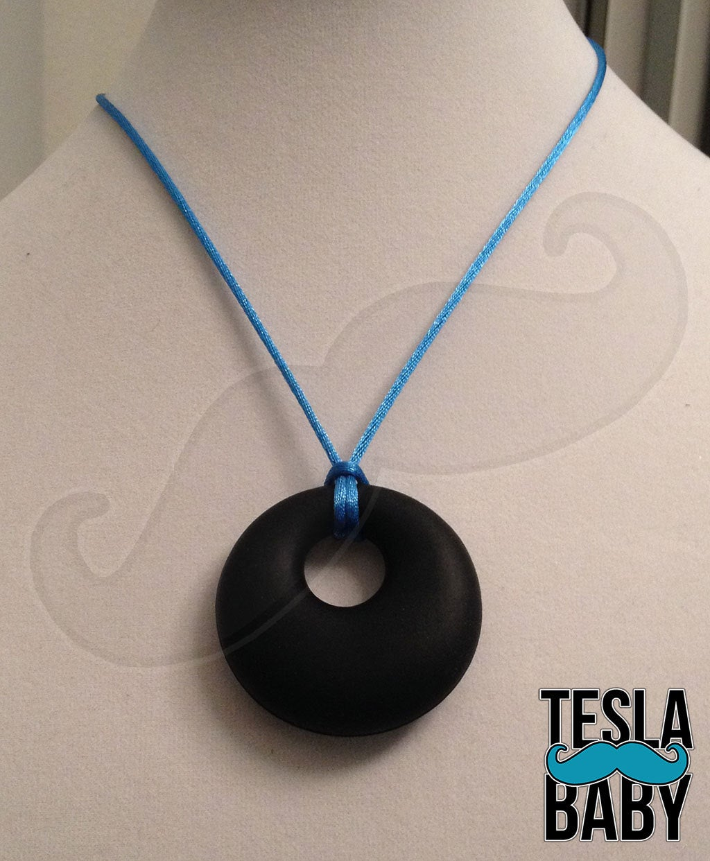 "Silicone Pendant Necklace --  A 2 1/8"" blue silicone circular pendant; for fidgeting, sensory play, or teething."