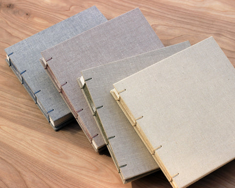 Four square sketchbooks, from left to right: sky gray, spice, bisque and linen.