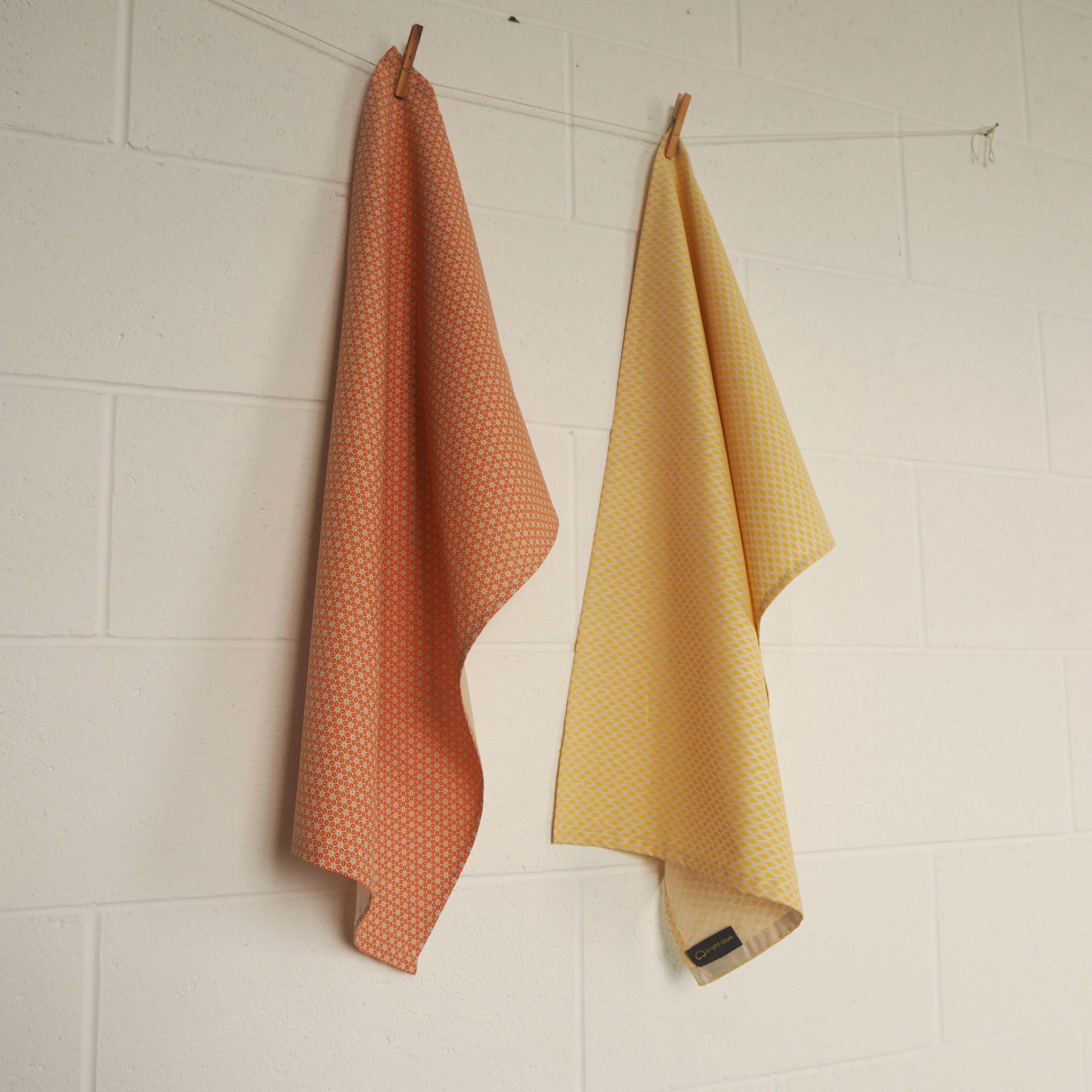 Set of Two Tea Towels Organic Cotton Orange Star and Yellow Triangle Patterns