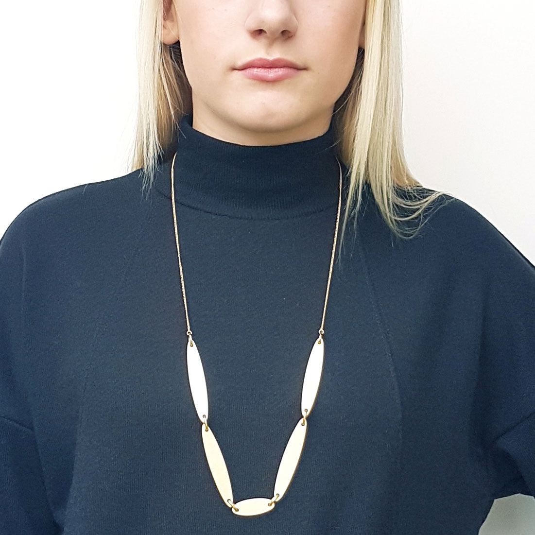 Branch Jewellery - necklace with white oval wood set on gold plated chain