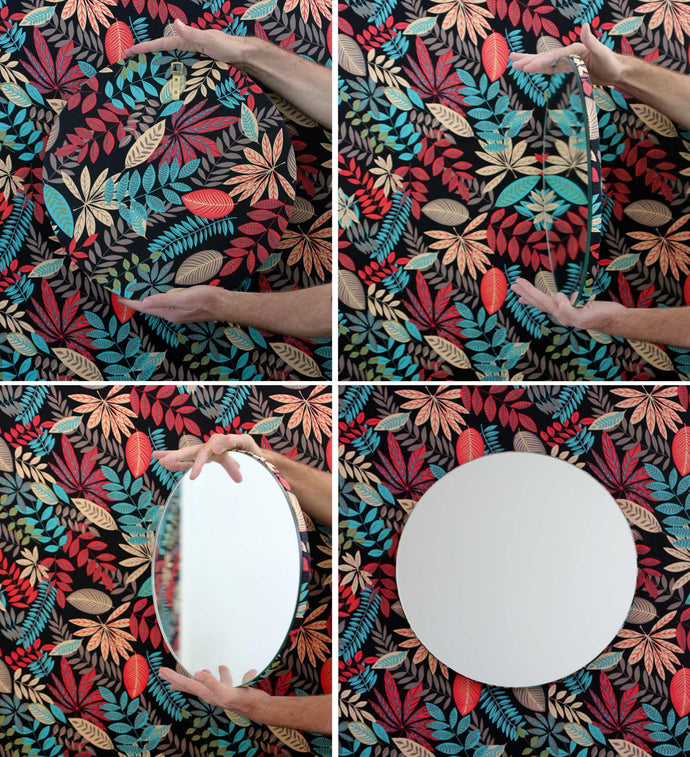 Silver Orbis round mirror™ with a hand printed fabric backing