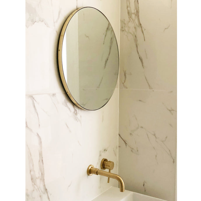 Round Orbis Round Mirror With a Brass Frame