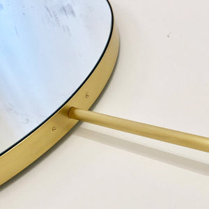 Orbis™ Arched Suspended Bathroom Silver Mirror with a brushed brass frame