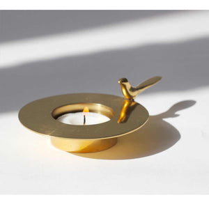 Handmade cast brass one bird tealight candle holder