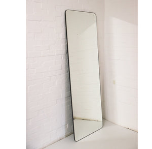 Wall Leaning Floor Mirror with a patinated frame