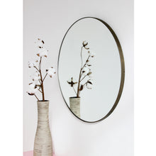 Silver Orbis™ round mirror with a bronze patina frame