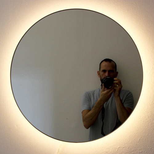 Round Orbis™ Back Illuminated Mirror with brass frame