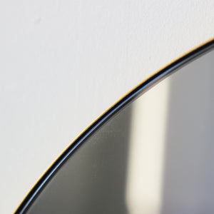 Orbis™ Round Black Tinted Mirror with Brass Frame