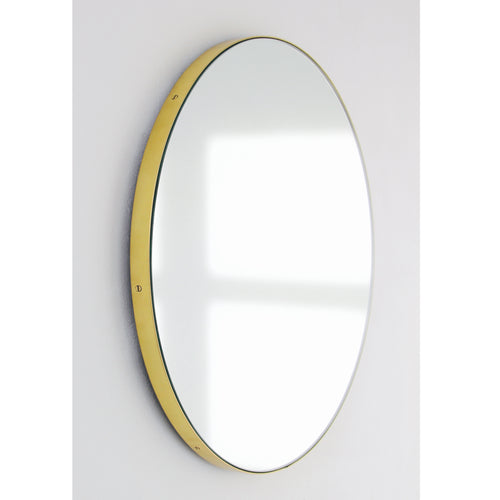 Silver Orbis round mirror™ with BRASS frame