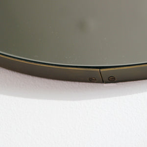 Silver Orbis round mirror™ with a bronze patina brass frame