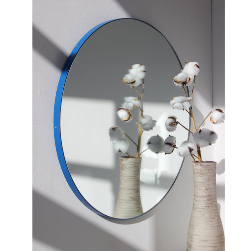 Silver Orbis™ round mirror with BLUE frame