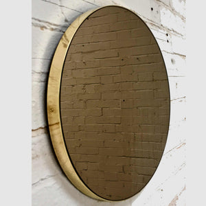 Bronze Tinted Orbis round mirror™ with BRASS frame