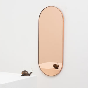 Capsula™ Capsule shaped Rose Gold Contemporary Mirror with a Copper Frame