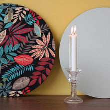 Silver Orbis™ round mirror with a hand printed fabric backing