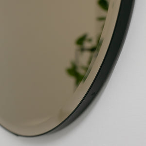 Orbis™ Bevelled Round Bronze Tinted Mirror with a Black Metal Frame