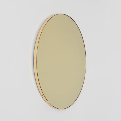 Orbis™ Round Gold Tinted Contemporary Mirror with a Brass Frame