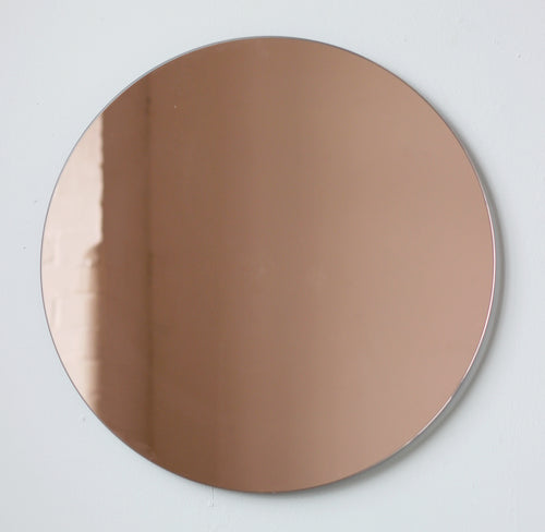 Orbis™ Rose gold / Peach Tinted Minimalist Contemporary Round Frameless Mirror
