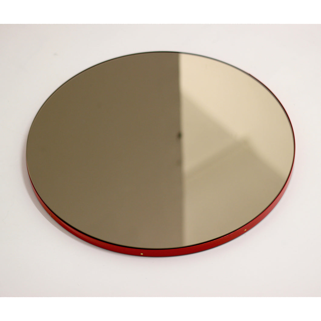 Bronze Tinted Orbis round mirror™ with RED frame