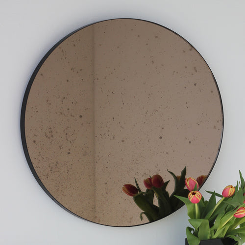 Orbis™ Antiqued Bronze Tinted Round Elegant Mirror with a Black Frame