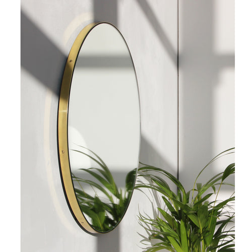 Silver Orbis™ round mirror with BRASS frame