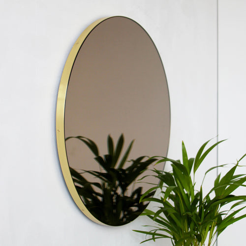 Bronze Tinted Orbis™ round mirror with BRASS frame
