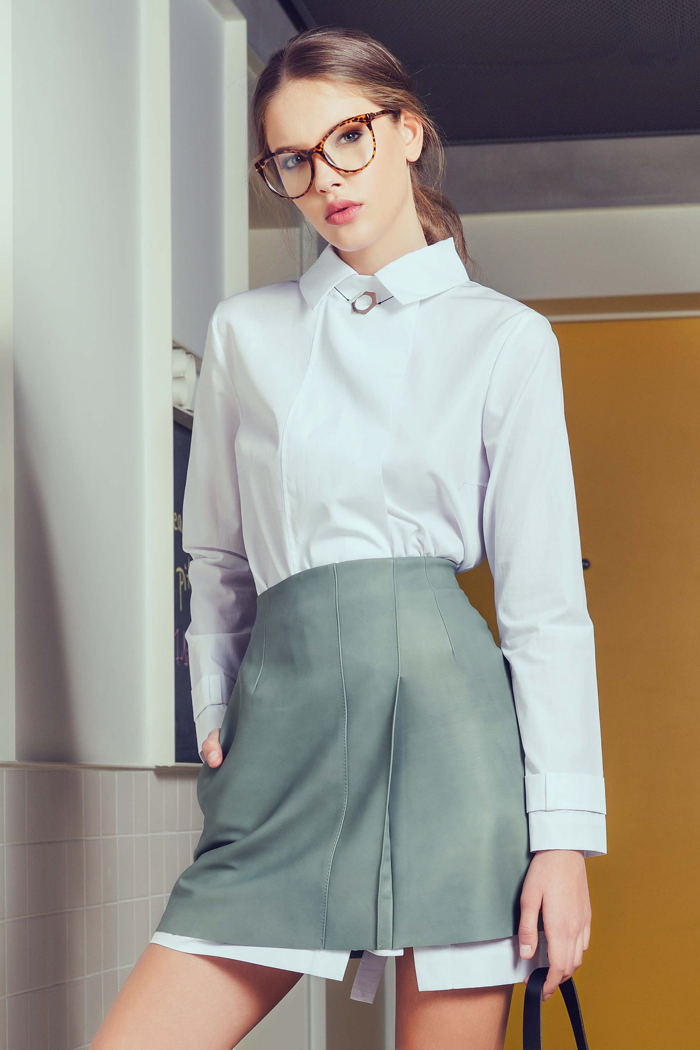 short leather skirt and white shirt
