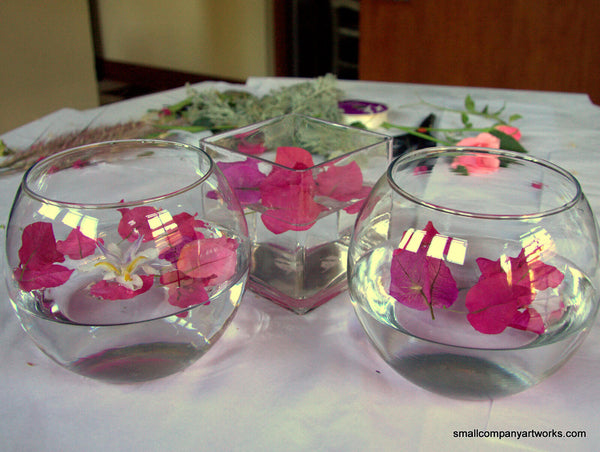 Three vases of floating flowers