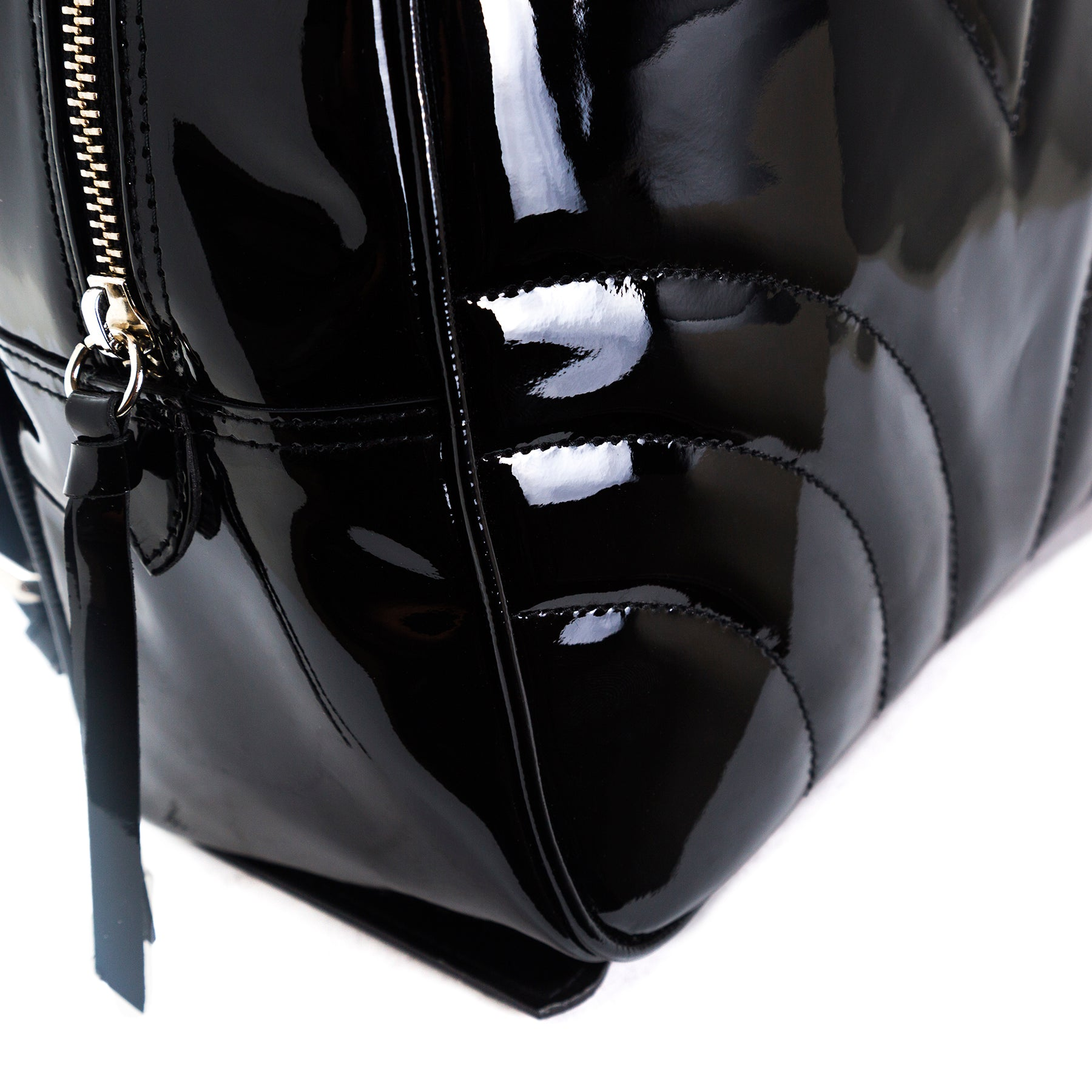 Foie Black Patent Backpacks