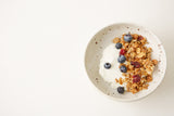 Persephone Bakery Quinoa Granola with Milk and Berries in Arhoj Bowl