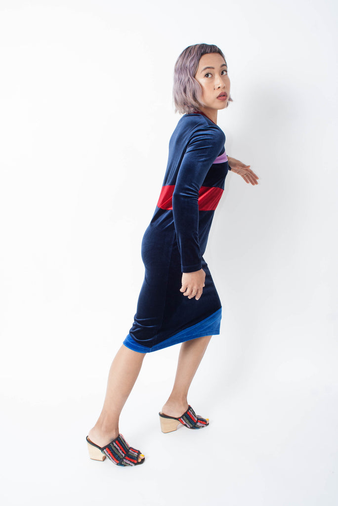 Carleen velvet long sleeve deep blue patchwork dress with red and lilac colorblocks paired with a Rachel Comey embroidered dahl mule