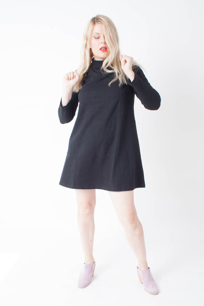 Loup Franc Dress is a mini shift dress in black with a mockneck and petite sizing