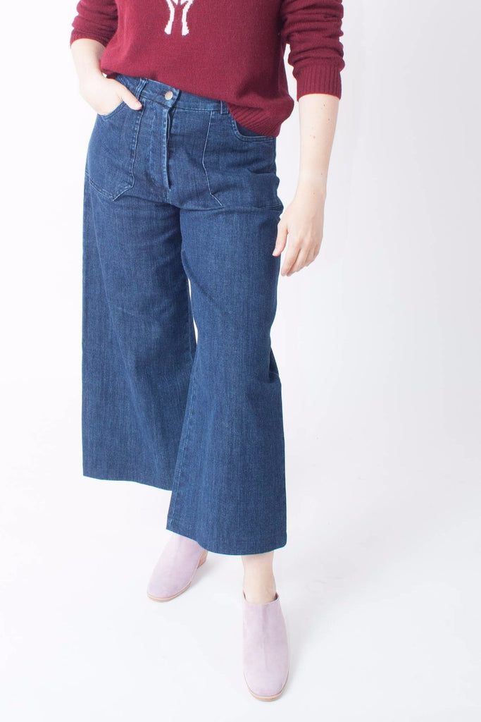Loup Simone Jean is high-waisted and wide-legged with hidden button fly and two 70s-inspired front trouser pockets in indigo