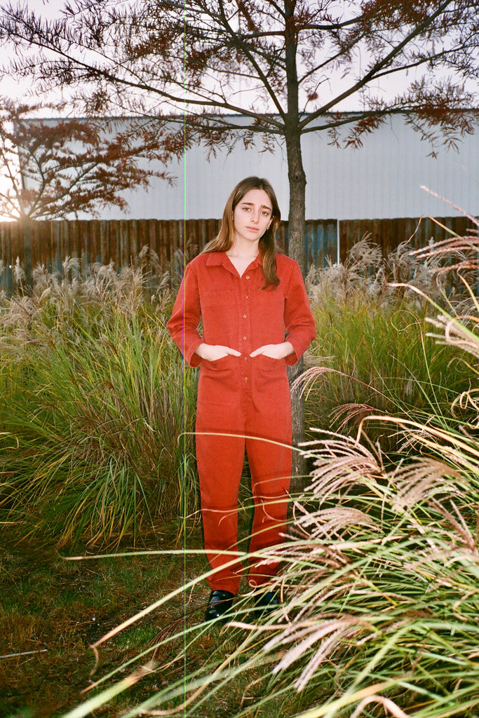 Jo Rosenthal in Ilana Kohn Petite Tia Long-Sleeved Coverall Jumpsuit in Terra exclusively at STATURE NYC | staturenyc.com