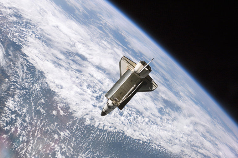 The Space Shuttle Atlantis over Earth