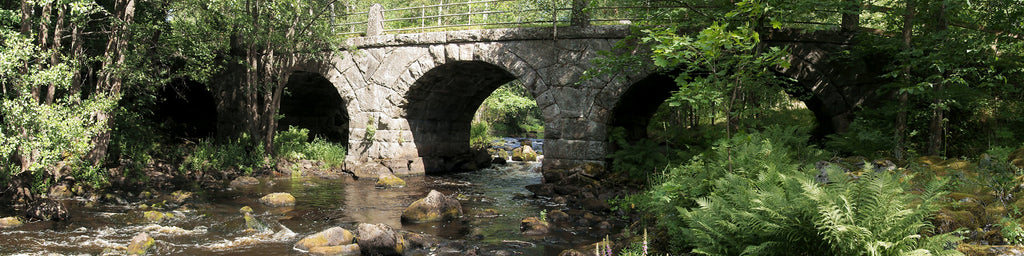ARCH BRIDGE OVER A CREEK