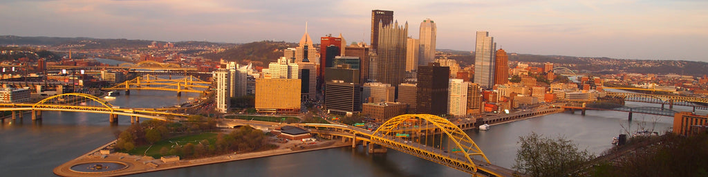 DOWNTOWN PITTSBURGH SKYLINE WITH SUNSET