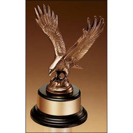 Fully modeled antique bronze eagle casting on a black wood base.