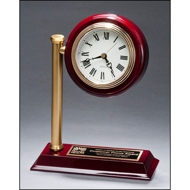 Rail station style desk clock on rosewood finish high gloss base.