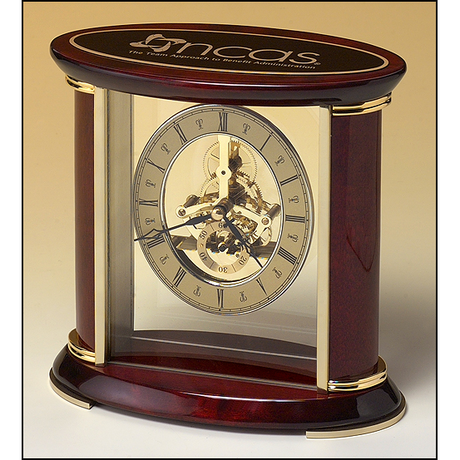 Skeleton clock with sub-second dial, brass finished movement and rosewood piano finish accents.
