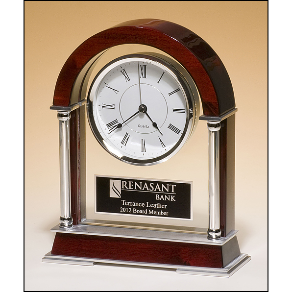 Mantle clock with rosewood piano-finish wood, chrome-plated posts and brushed silver aluminum accents.