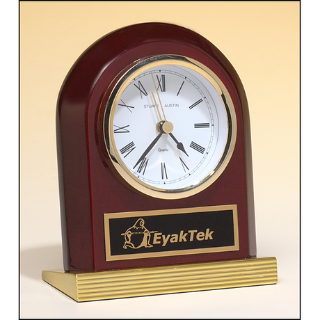 Rosewood piano-finish clock with gold metal base.