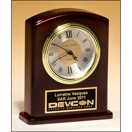 High gloss rosewood finish clock, diamond-spun dial and three hand movement.