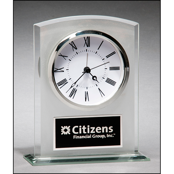 Glass clock with frosted top polished edges and base.