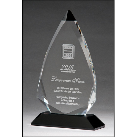 Arrow shaped crystal award with black accent on black crystal base.
