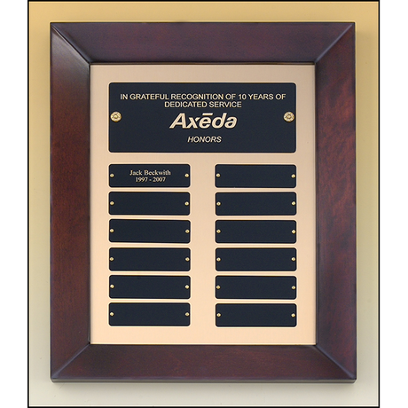 Cherry finish frame perpetual plaque with 12 black brass plates on brush metal gold background.