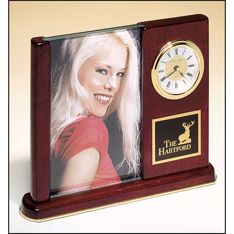 Rosewood stained piano finish desk clock with glass picture frame.