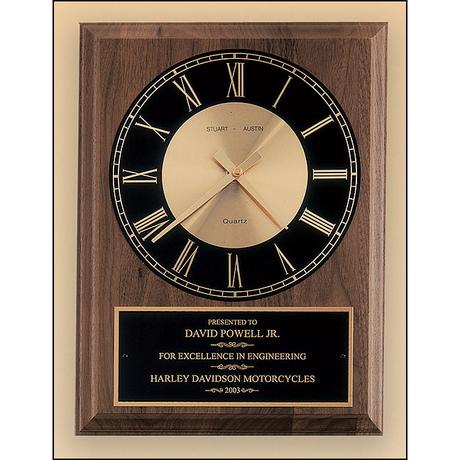 American walnut vertical wall clock with round face.
