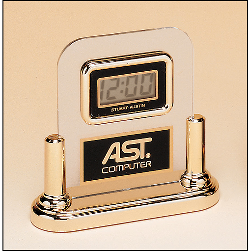 Acrylic clock with LCD movement on a gold base.
